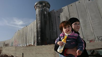 Mother and child by west bank barrier
