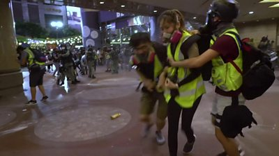 Protesters running away from pepper spray