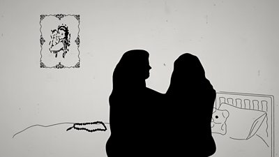 Silhouette of two women hugging