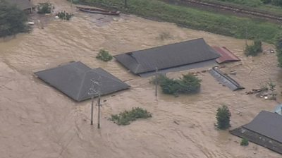 Houses in Japan submerged in water.