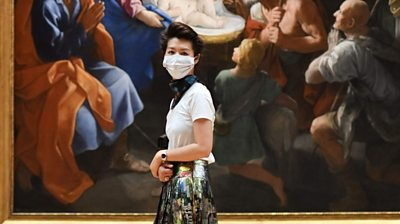 Woman wearing mask in National Gallery, London