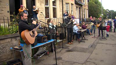 A band performed in Glasgow's Dumbarton Road to say thanks to the NHS