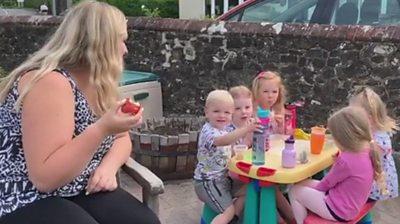 Children at nursery with teacher