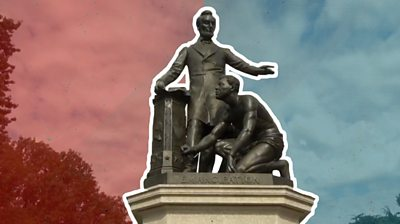 A statue of Abraham Lincoln with a slave in Washington, DC