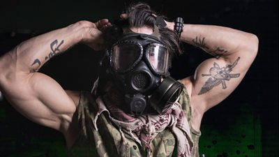 Marine Corp Sgt Reyes wears a gas mask