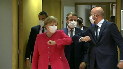 Angela Merkel and Charles Michel elbow tapping