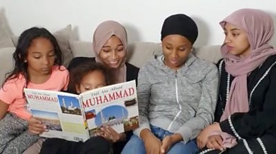 Family reading a book