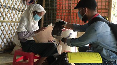 A medical volunteer tends to a refugee