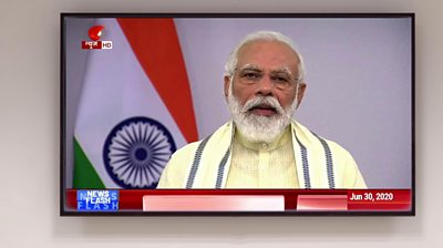 Narendra Modi giving a speech on TV