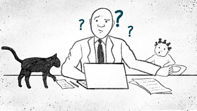 Man sitting at a desk, laptop open, black cat on his right and baby on his left. There are question marks around his head.