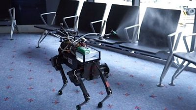A robot spraying disinfectant