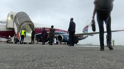 People queuing up to board a flight in Nigeria