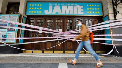 A person walks past a closed theatre in London in a file photo dated 6 July 2020