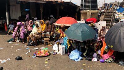People sitting in the floor in Okobaba