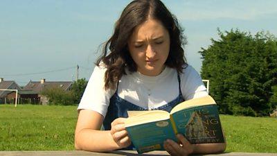 Gwenllian Griffiths reading a book