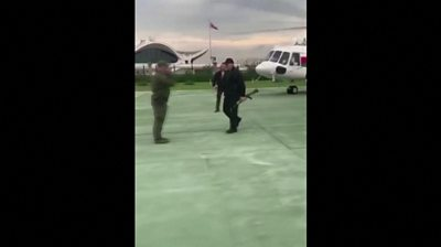 Lukashenko carries assault rifle as he gets off helicopter
