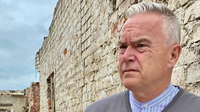 BBC newsreader and presenter Huw Edwards visits the remains of the German POW camp where his grandfather was held.