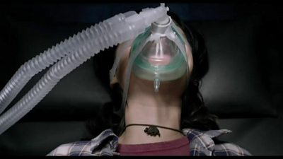 A woman wearing a mask in a scene from The New Mutants