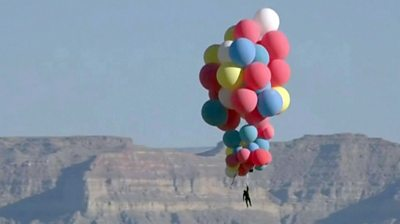 David Blaine holds on to balloons