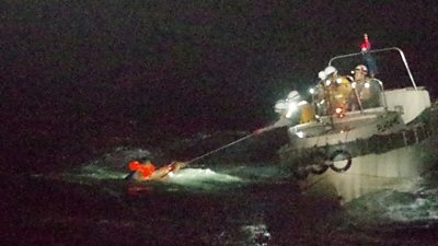 Person pulled from water by coastguard