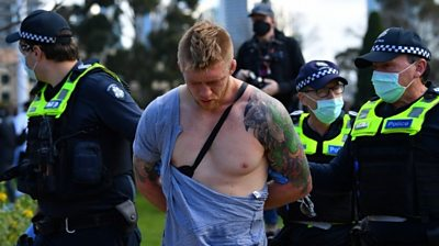 Man with ripped shirt is arrested in Melbourne