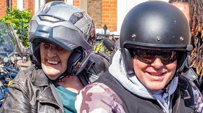 Anne Turner on the back of a Harley-Davidson