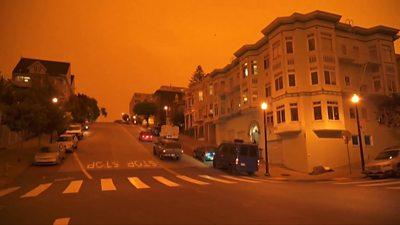 A San Francisco street with an orange sky