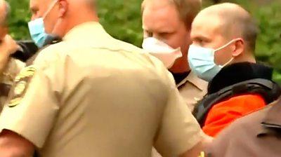 Derek Chauvin leaving court