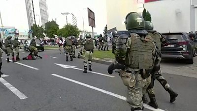 Riot police chasing demonstrators