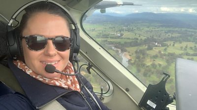 Selfie of woman flying light plane