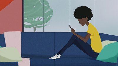 sad girl looking at phone