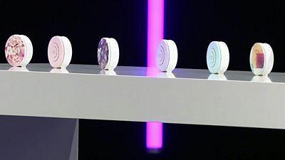 A row of six wearable air purifers