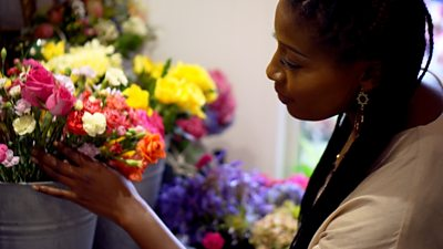 Kamilah holding a bunch of flowers