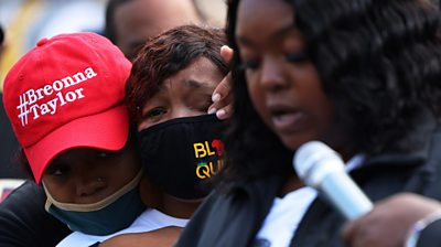 Breonna Taylor's mother Tamika Palmer cries as her sister Bianca Austin speaks