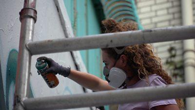 Female street artist at work