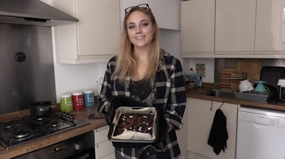 Immy Ray holding a cake taken out the oven