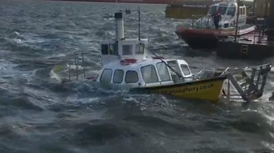 Harwich Harbour Ferry half submerged in gale-force winds
