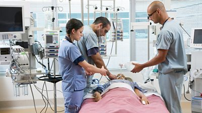 Doctors with a patient in an intensive care unit