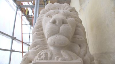 Stone carving of a lion's head