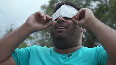 BBC Click's Omar Mehtab puts a face mask over his eyes