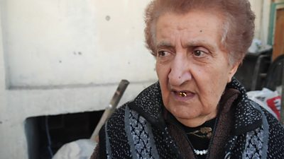 Pensioner whose home was destroyed by shelling
