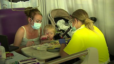 A child plays after surgery