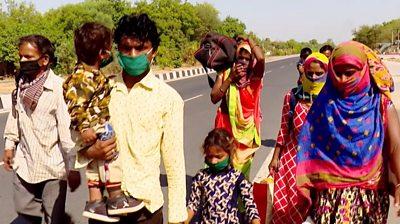 Family walking beside highway