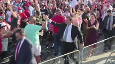 Ron DeSantis high-fives supporter at Trump rally