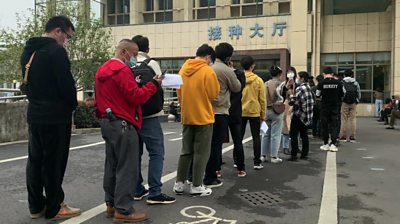 Hundreds queue in Yiwu, China for experimental Covid-19 vaccine