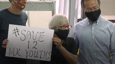 Alexandra Wong with a placard