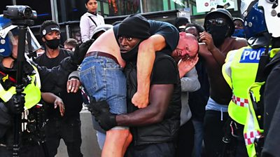 Viral image of Patrick Hutchinson helping a counter-protester transformed into music and poetry.