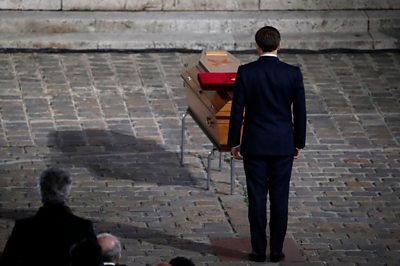 "The French President described Samuel Paty as a ""quiet hero"" at a memorial in Paris."