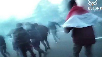 Protesters flee stun grenades