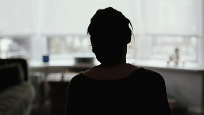 A silhouette of a woman who survived domestic abuse